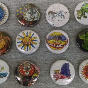 Set of 12 Jamie Hayes buttons/pins assortment includes cats, suns, flying pig, unicorn, more